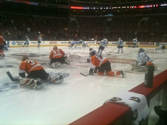 Philadelphia Flyers and Toronto Maple Leafs warming up before a game